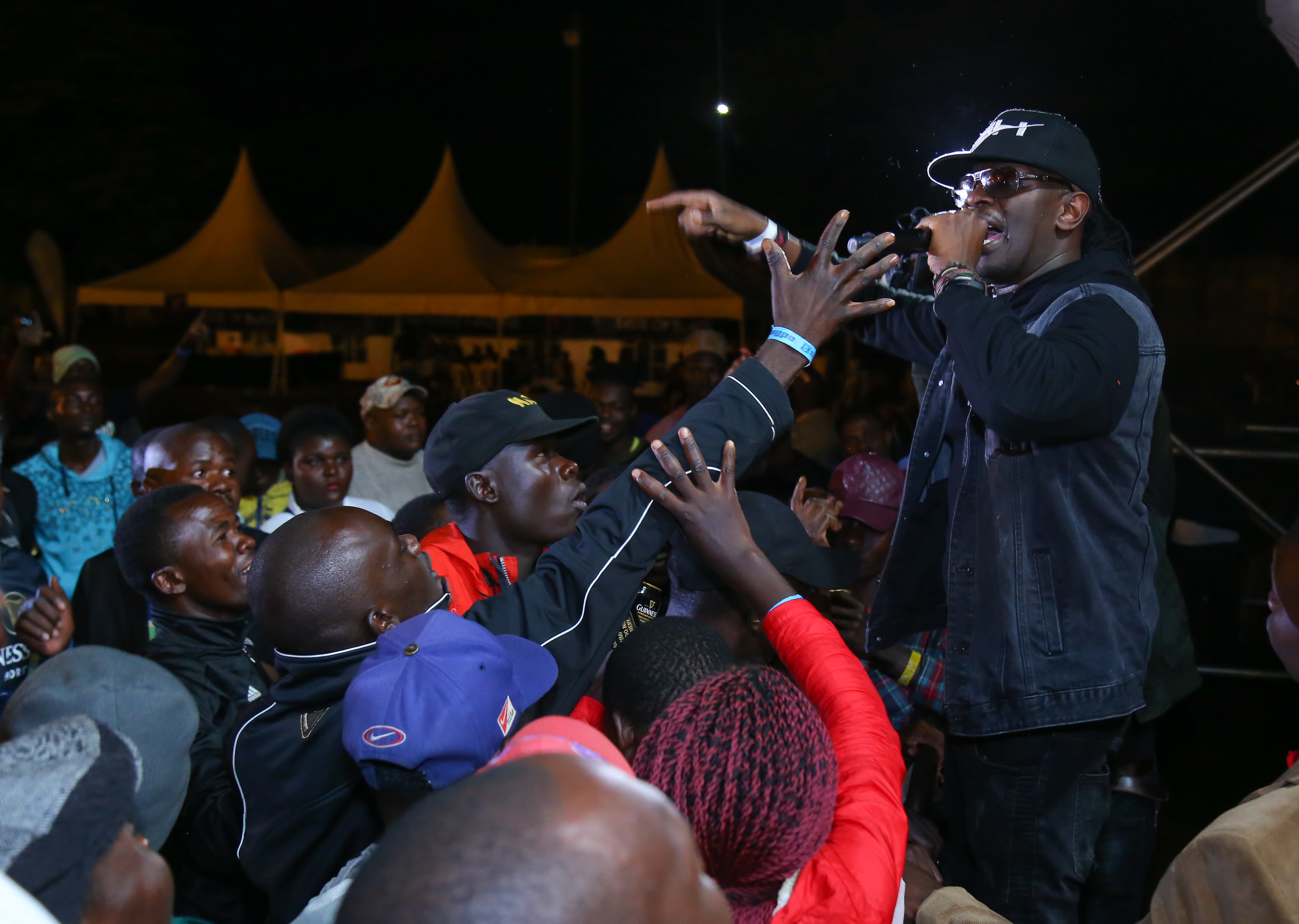 Photo:Nameless engages with the crowd on stage during the Guinness Fanzone Experience held at Simba Union Club in Kisumu.